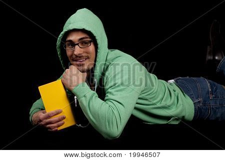 Man In Green With Yellow Book