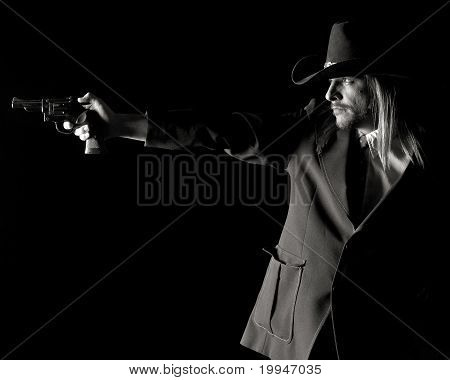 Man In Cowboy Hat Aiming Pistol.