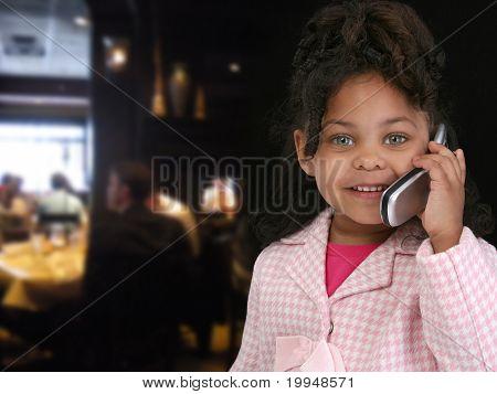 Child On Cellphone In Restaurant