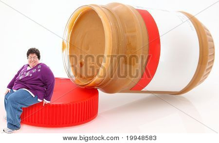 Happy Overwieght Forty Year Old Woman Sitting On Peanut Butter Jar