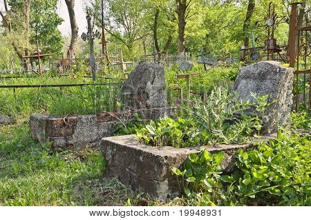 Graveyard: Old Abandoned Graves And Rusty Crosses