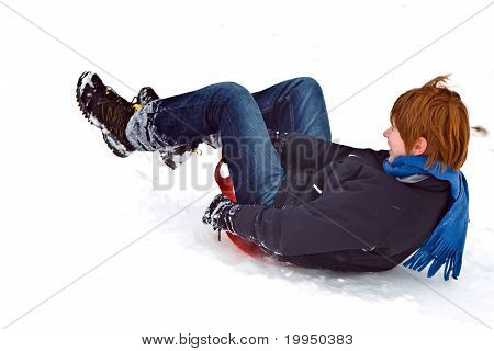 Child Sledding Down The Hill In Snow, White Winter