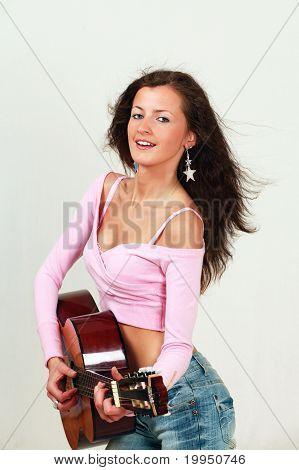 Pretty girl playing guitar