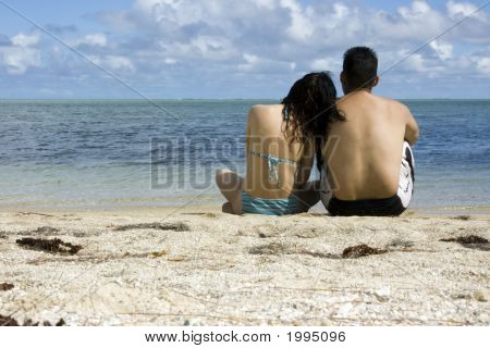 Lovers On Island Looking Out To Sea