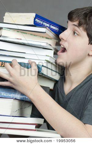 Teen Tries To Carry Unbalanced Stack Of Textbooks