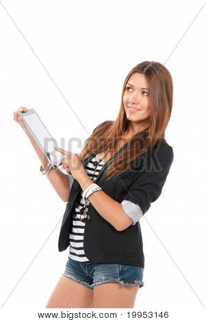 Brunette Woman Typing On Her New Electronic Tablet Touch Pad Computer
