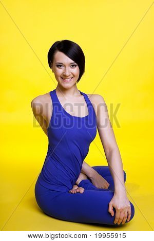 Beauty yong woman smile in lotos pose