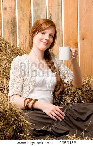 Young Romantic Woman In Barn Holding Cup