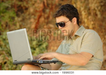 Person Working On A Laptop