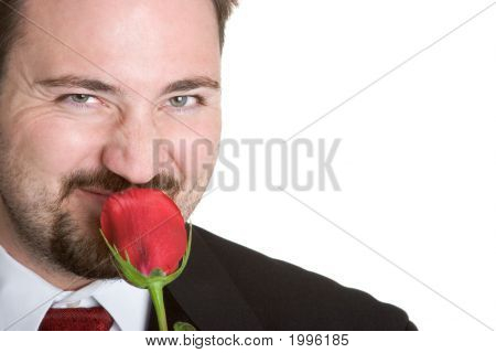 Man Smelliing Rose