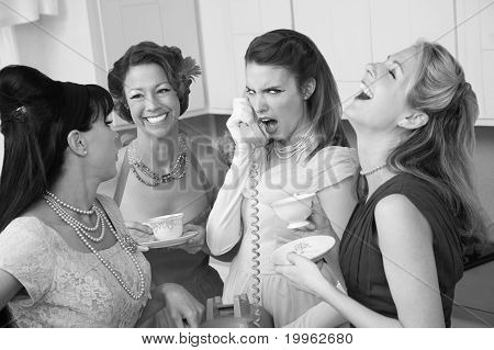 Woman Laughing At Friend On Phone
