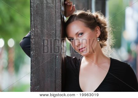 Young Woman On The Porch