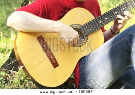 Teenage Boy Playing The Acoustic Guitar
