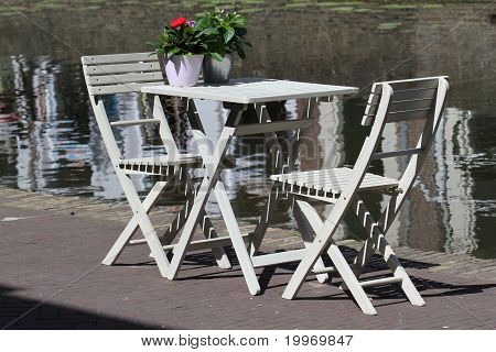 Two White Chairs In From A Delft Canal