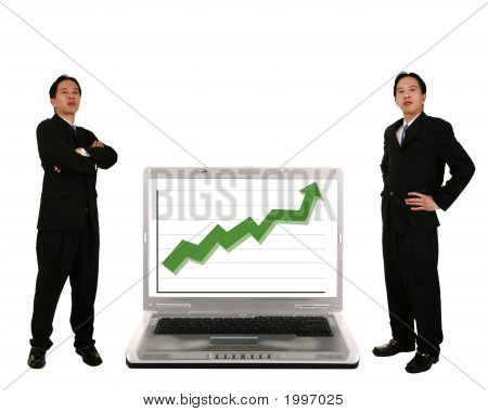 Stand Beside Laptop With Stock Chart 2