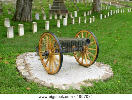 Canon In Front Of Military Graves