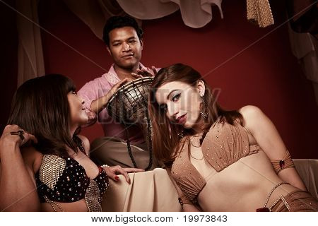 Two Belly Dancers With Indian Man