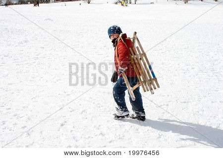 Young Boy Sledding Down
