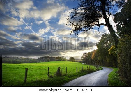 Country Road In English Countryside In Autumn