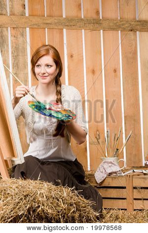 Red-hair Romantic Woman Painting In Barn Country
