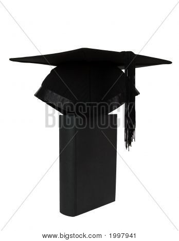 A Graduation Mortar On Top Of A Book