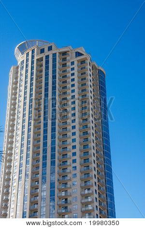 High Rise Luxury Condo With Balconies In Blue Sky