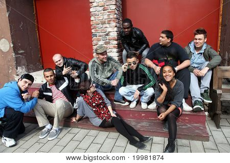 Ten Young People Sit Together And Have Fun.