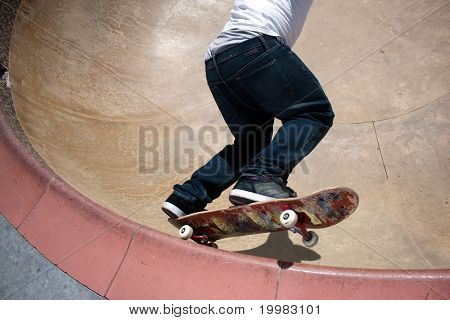 Skateboarder Skating Inside The Bowl