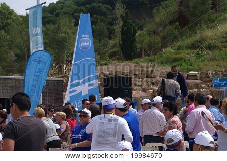People attending a political meeting 06