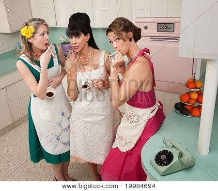 Women Enjoying Cup Of Coffee
