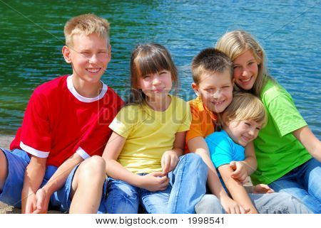 Happy Children By The Lake.