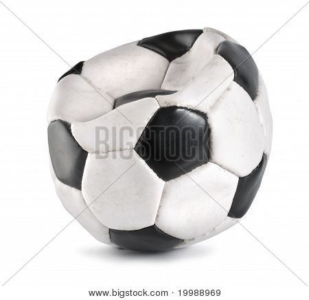 Deflated soccer ball isolated