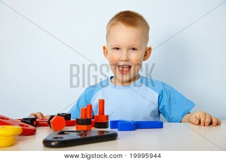 Happy Little Boy Playing With Toys
