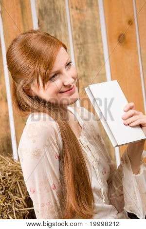 Young Romantic Woman Hold Book In Barn