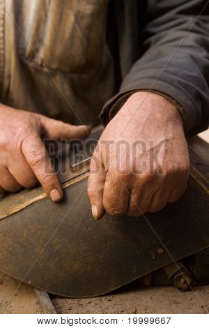 Hands Of The Metallurgist Working