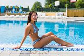 Beautiful Sexy Luxurious Girl Lies On The Edge Of The Swimming Pool, Sunbathing, Tanned Perfect Body poster