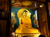 stock photo of siddhartha  - Golden Buddha in the Mahabodhi Temple Bodhgaya Bihar India - JPG
