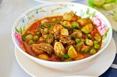 Spicy Oyster Soup With Variety Of Herbs poster