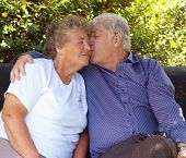 stock photo of swinger  - Couple of old swingers having a cuddle - JPG