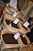 Coffee grains in bags of different grades on sale