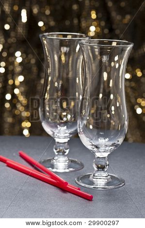 Long Drink Glasses, Highball Glasses With Straws In Front Of Glitter Background