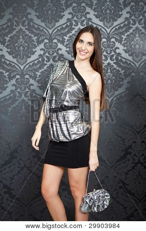 young , fashion woman in evening silver dress