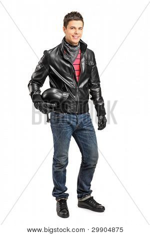 Full length portrait of a young motorcycler holding a helmet posing isolated on white background