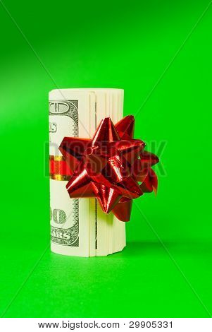 A Wad Of Us One Hundred Dollar Bills Tied Up With Red Ribbon