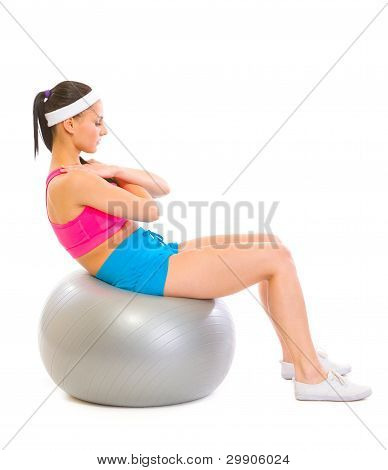 Fitness Girl Making Abdominal Crunch On Fitness Ball