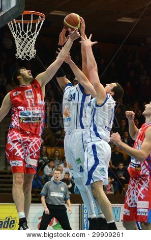 KAPOSVAR, HUNGARY - JANUARY 28: Unidentified players in action at a Hungarian Championship basketball game with Kaposvar (white) vs. Nyiregyhaza (red) on January 28, 2012 in Kaposvar, Hungary.