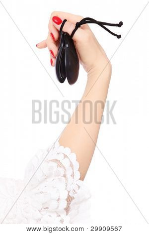 Woman's hand with castanets over white background