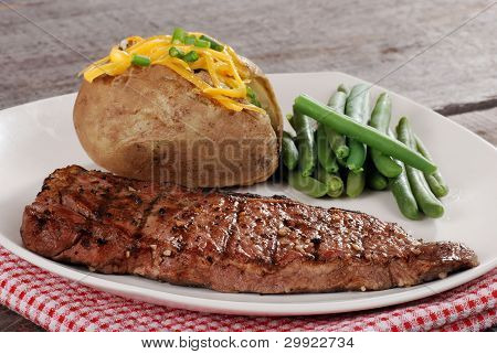 closeup barbecue steak with vegetables