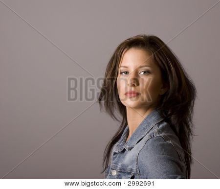 Brunette In Denim Sultry Look