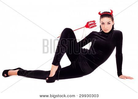 sexy brunette girl wearing a costume of an imp, isolated on white background
